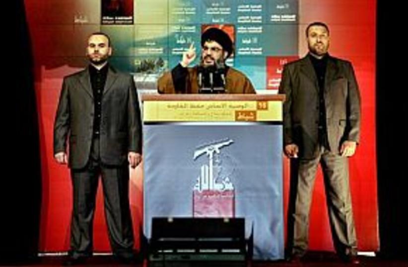 nasrallah with bodyguard (photo credit: AP)