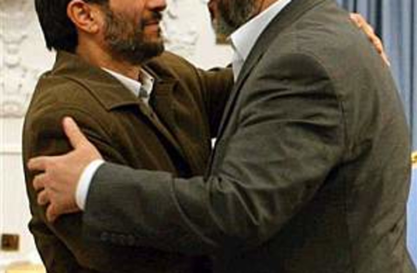 ahmadinejad mashaal 298. (photo credit: AP [file])