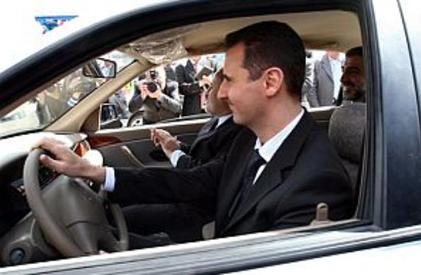 assad driving and happy  (photo credit: AP)