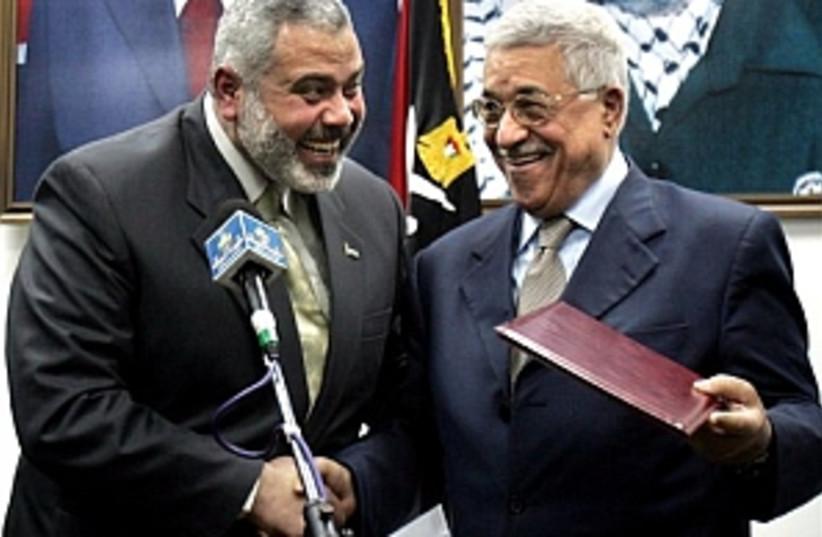 abbas haniyeh big smiles (photo credit: AP [file])