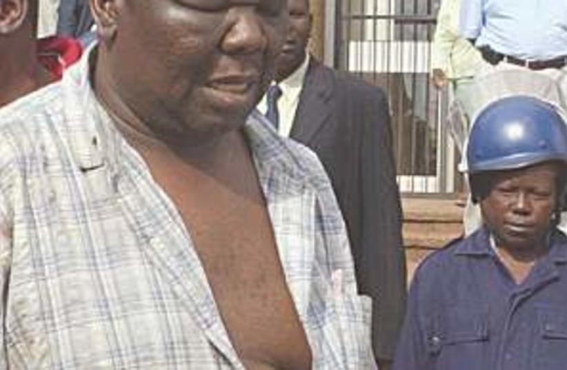 zimbabwe beating 298.88 (photo credit: AP)