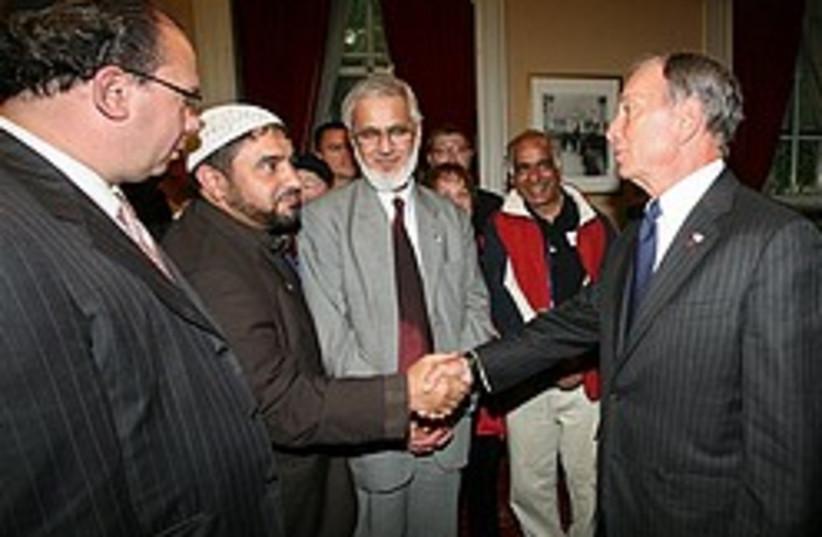 New York City Mayor Michael Bloomberg, right, gree (photo credit: AP)
