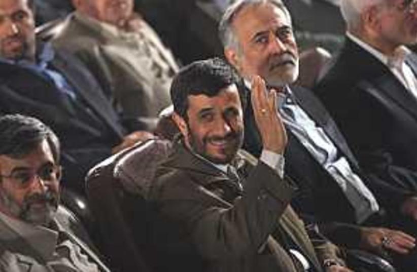 ahmadinejad smiles waves (photo credit: AP [file])