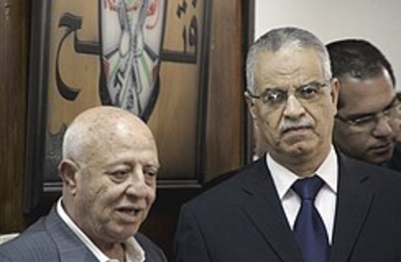 Fatah official Ahmed Qurei with Mohammed Ibrahim,  (photo credit: AP)