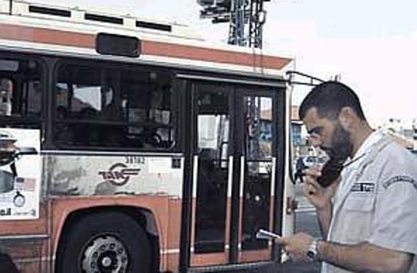 bus guard ij 298.88 (photo credit: Chaya Hyams)
