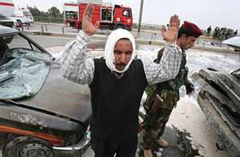 iraq bridge attack 298.8 (photo credit: AP)