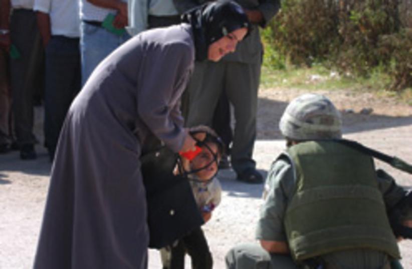 soldiers checkpoint cute 248.88 (photo credit: Ariel Jerozolimksi)