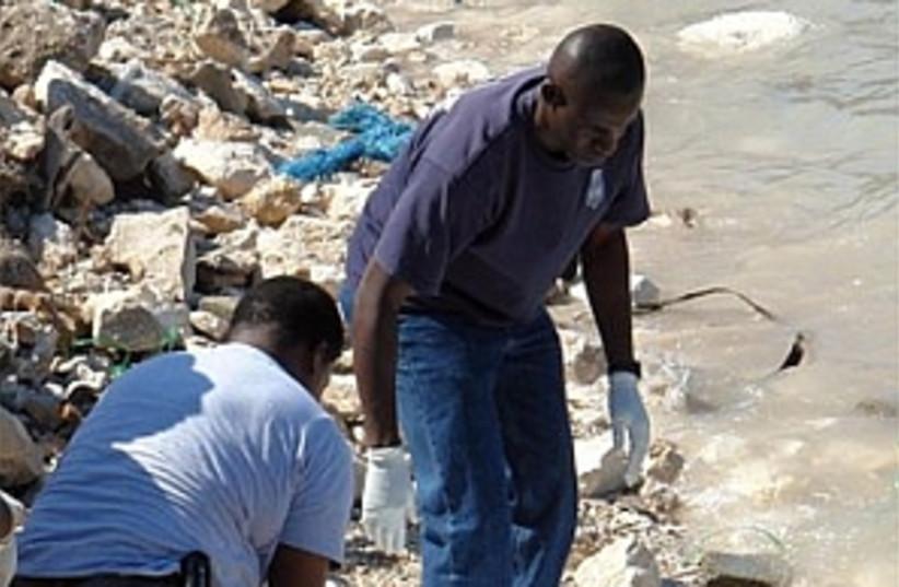 Haitian  298.88 (photo credit: AP)