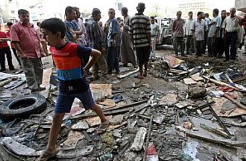 Iraqi bomb aftermath 298 (photo credit: AP)