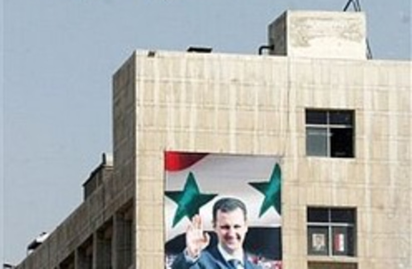 Assad plastered 248 88 (photo credit: AP)