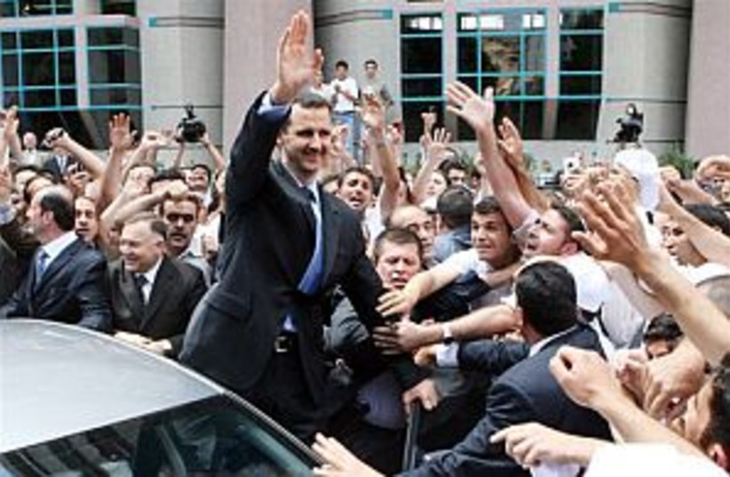 Assad waves to crowd 298 (photo credit: AP)