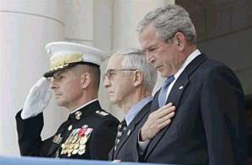 bush solemn 298 88 (photo credit: AP)