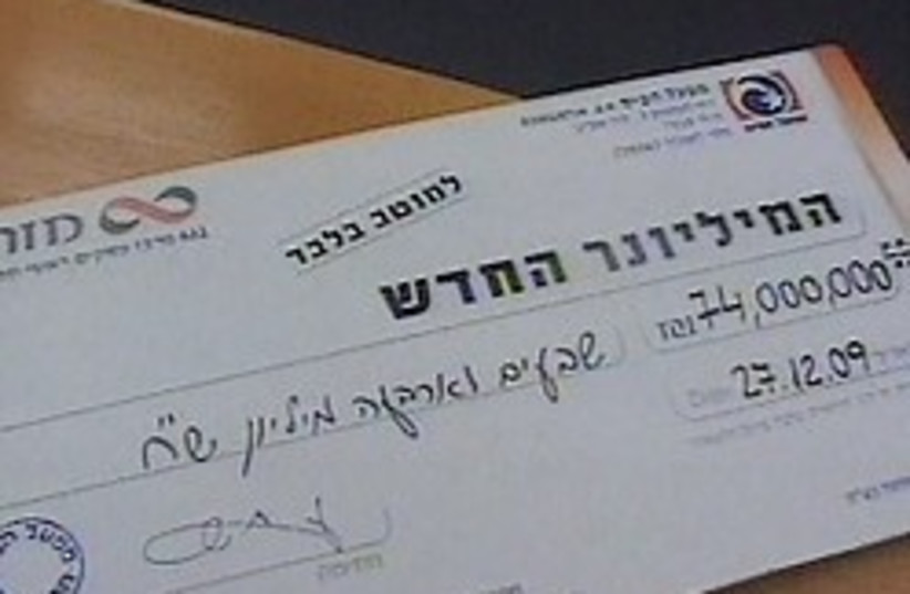NIS 74 million lottery check 248.88 (photo credit: Channel 1)