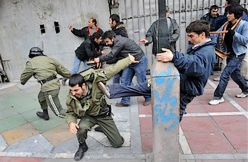 Iran protesters beat police 248.88 (photo credit: )