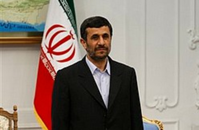 Ahmadinejad flag 248.88 (photo credit: AP)
