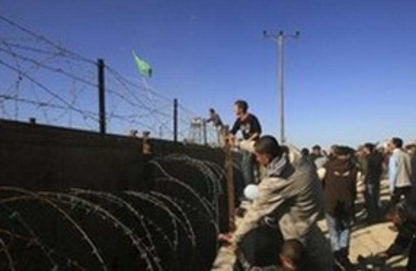 Palestinian Hamas supporters throw stones  (photo credit: AP)