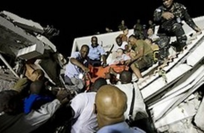 Search and rescue efforts at the UN headquarters in Haiti (photo credit: AP)