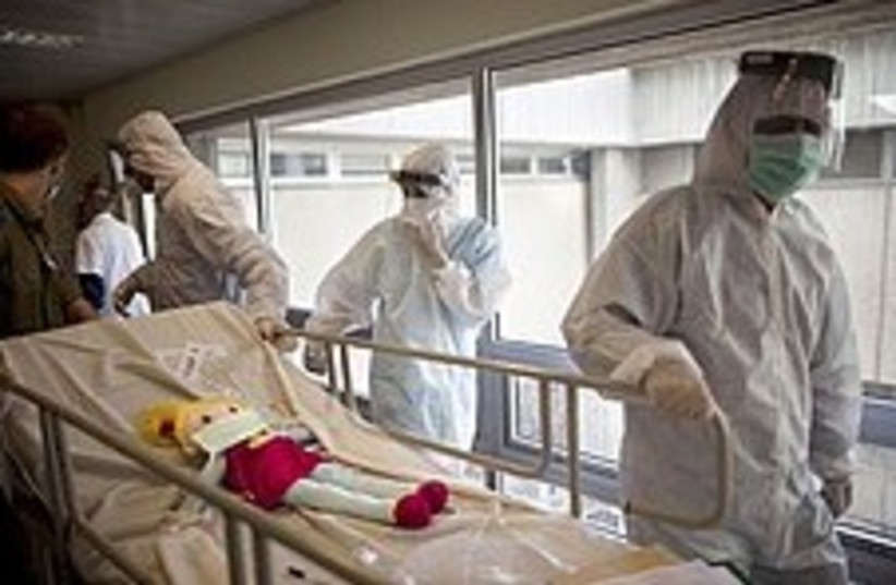 Paramedics during an exercise simulating a chemical attack (photo credit: AP)