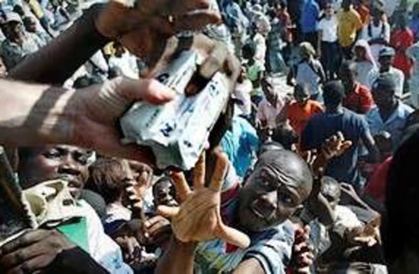 haitians reach for aid AP 311 (photo credit: AP)