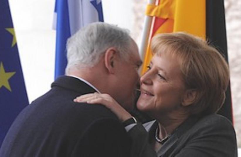 Netanyahu embraces Merkel, Monday. (photo credit: GPO)