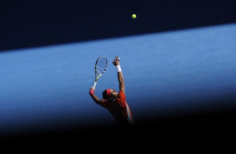 Rafael Nadal at the Australian Open (photo credit: AP Photo/Andrew Brownbill)