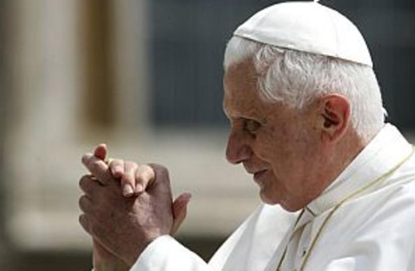 pope prays 298.88 (photo credit: AP [file])