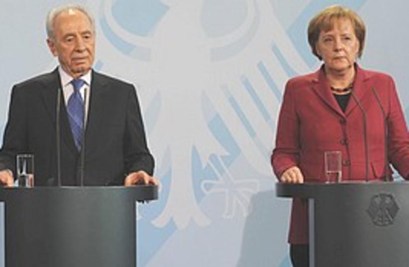 Merkel Peres  (photo credit: GPO/Amos Ben-Gershom )