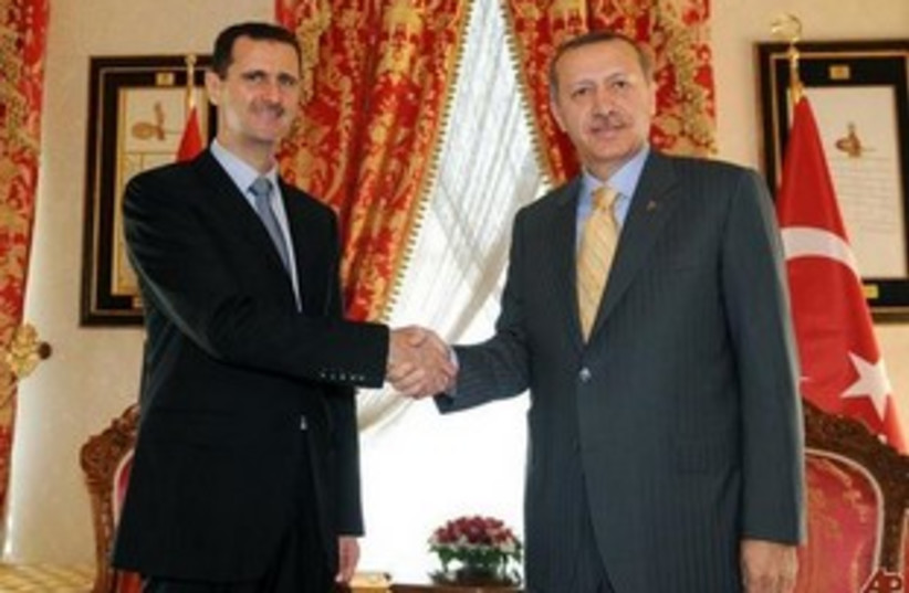 Erdogan Assad  (photo credit: AP)