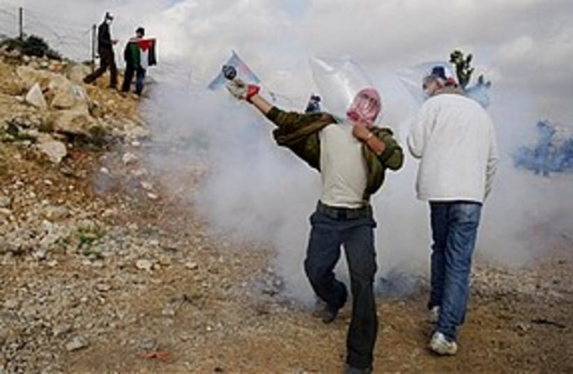 bil'in protest 311 (photo credit: ASSOCIATED PRESS)