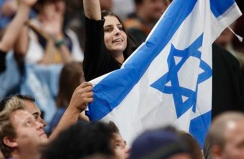 casspi fan israel flag 512 ap (photo credit: AP)