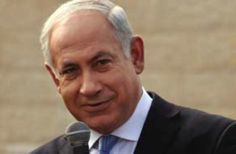 Bibi smiling and pointing 311 ap (photo credit: Associated Press)