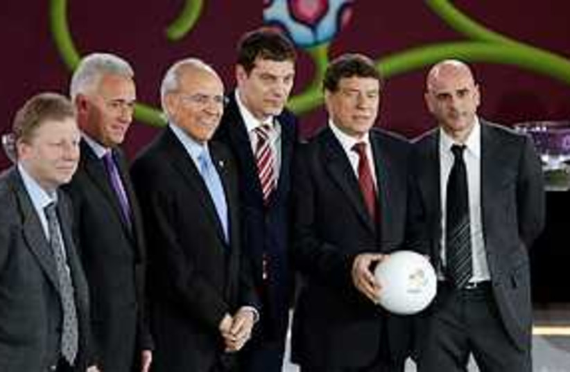 Group F coaches and officials (photo credit: ASSOCIATED PRESS)