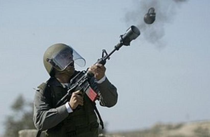 border police tear gas brilli 311 (photo credit: AP)