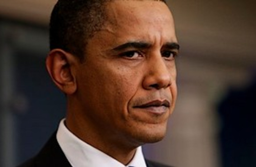 Obama serious 311 (photo credit: AP)