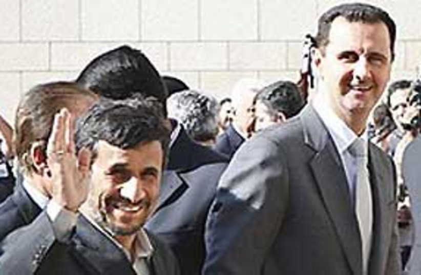 assad ahmadinejad 311 (photo credit: AP)