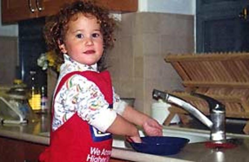 girl washing dishes 311 (photo credit: Courtesy)