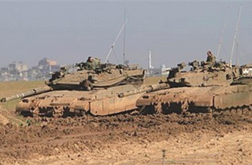 IDF tanks near Gaza 311 (photo credit: Associated Press)