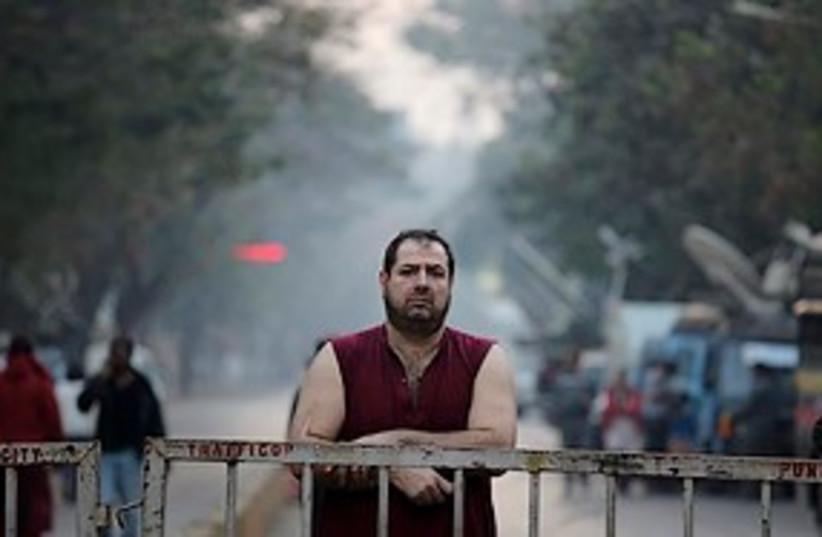 sad white man after mumbai bombing near chabad house 311 ap (photo credit: ASSOCIATED PRESS)