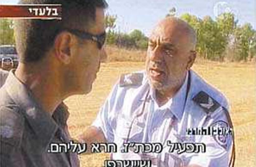 Abusive Shaham 298.88 (photo credit: Channel 10)