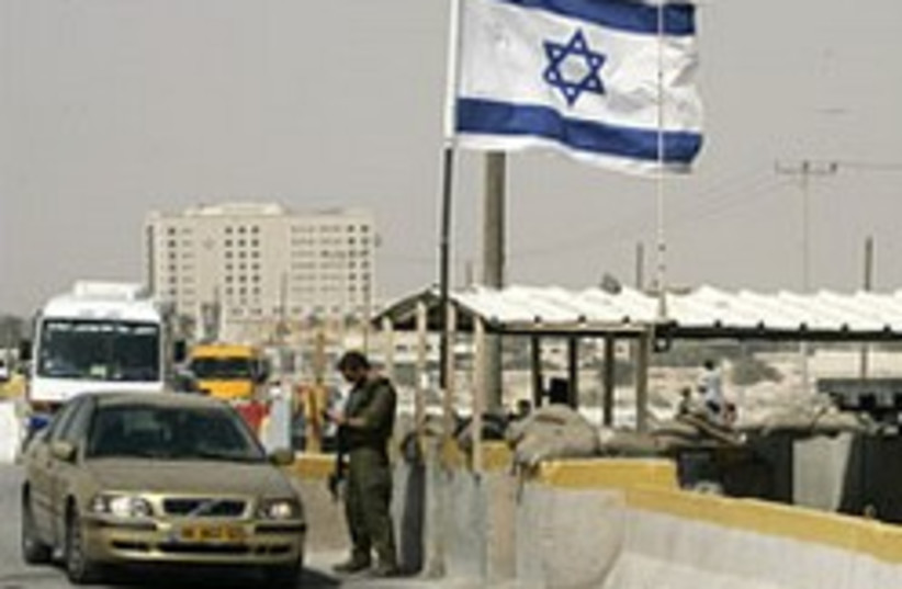 An IDF soldier inspects a Palestinian vehicle at t (photo credit: AP)