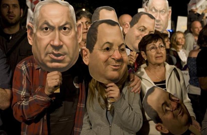 Israeli left-wing activists wearing masks (photo credit: AP)