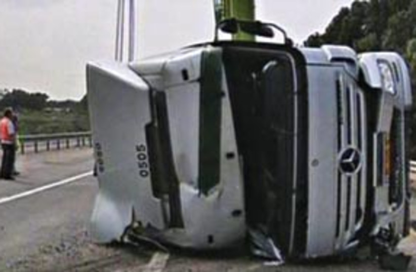 overturned truck 311 (photo credit: Channel 2)
