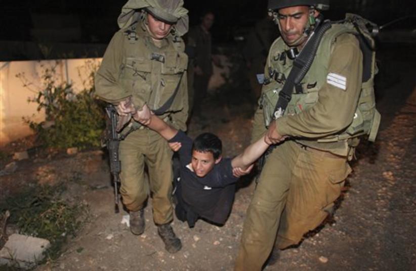 Israeli soldiers detain Jewish settler in Jericho (photo credit: AP)