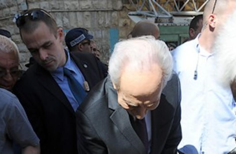 President Shimon Peres in Iraqi shuk 311  (photo credit: Moshe Milner)