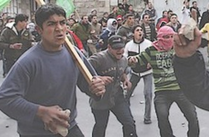 Palestinian rioters 311 (photo credit: Associated Press)