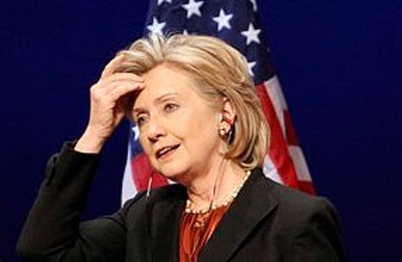Clinton scratches head 311 (photo credit: Associated Press)