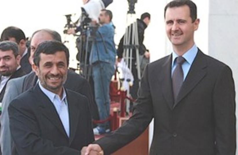 Assad Ahmadinejad 311 (photo credit: Associated Press)