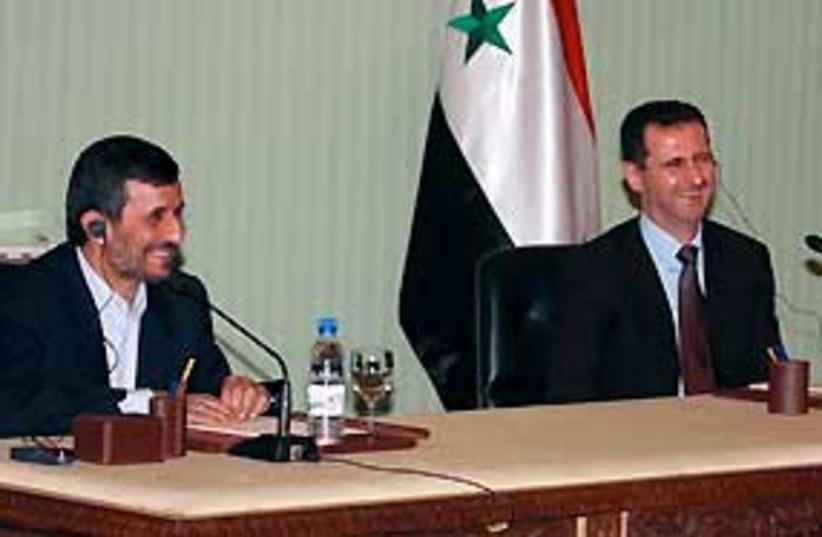assad ahmadinejad 311 (photo credit: AP)