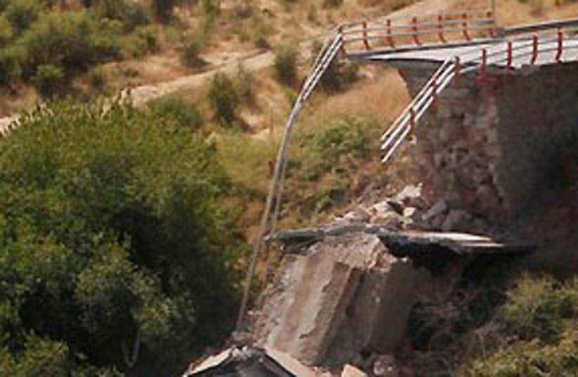 chile quake collapsed bridge 311 (photo credit: AP)