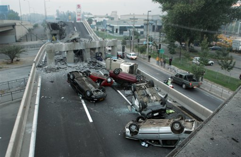 collapsed highway near Santiago (photo credit: AP)